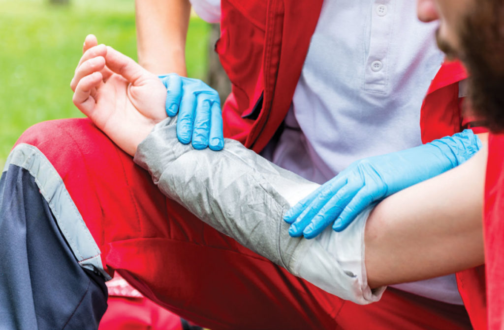 Patient's arm being treated with compression wrap